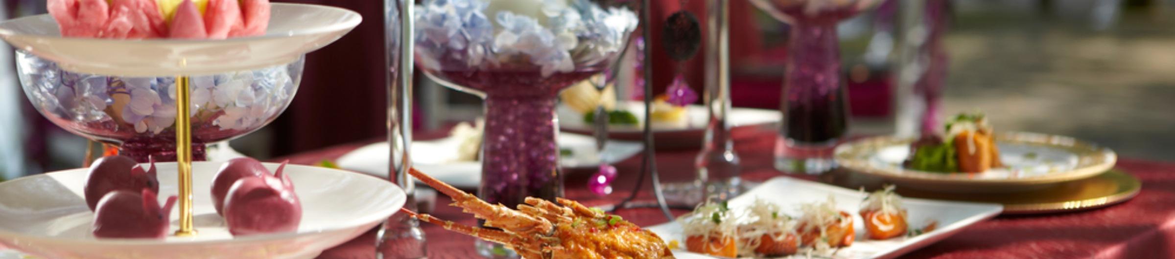 Lobster dish set on fancy table outside in gardens