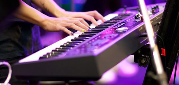 A person playing a keyboard