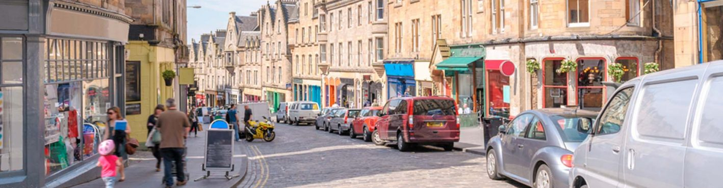 Edinburgh street with shops and shoppers on it