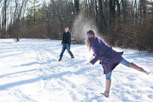 Couple enjoying a snowball fight