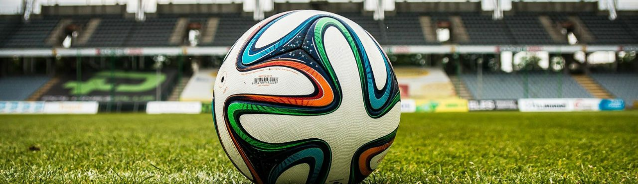 A football within a stadium, artistically shot.